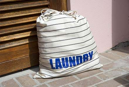"A bag of laundry labelled ""laundry"""